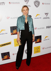 Radha Mitchell looked smart in a blue cropped jacket layered over a black jumpsuit when she attended the Australians in Film Awards Gala.