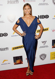 Renee Bargh channeled her inner goddess in a draped blue evening dress with a plunging neckline during the Australians in Film Awards Gala.