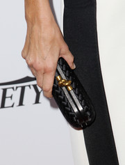 Erica Packer went to the Australians in Film Awards Gala carrying a black Bottega Veneta Knot clutch.