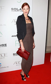 Amanda Righetti wore a brown draped strapless dress made of a soft knit on the red carpet of the Autumn Party.