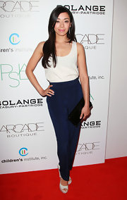 Aimee Garcia embodied minimalist chic in a pair of high-waist silk navy slacks.