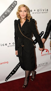 Madonna wore a black trench coat with sheer tights for the Bent on Learning Benefit in NYC.