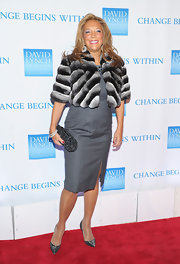 Denise Rich added sparkle to her red carpet look with an embellished black and silver clutch.