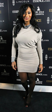 Toccara Jones arrived at the 2nd Annual Essence Black Women in Music event wearing a gray fitted mini dress.