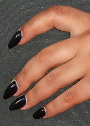 Pia Toscano topped off her edgy, Gothic-inspired red carpet look with these deep plum nails.