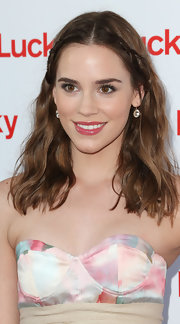 Christa B. Allen kept her look feminine-chic with this shiny pink lip gloss.