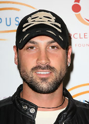 Maksim Chmerkovskiy wore a baseball cap to a charity event in Los Angeles.