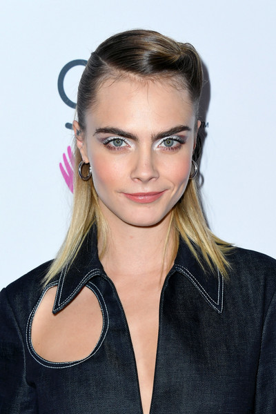 Cara Delevingne wore a twisted half-up hairstyle at the 2019 Girl Up #GirlHero Awards.