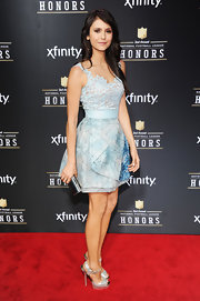 Nina Dobrev paired her pale blue dress with silver platform pumps.