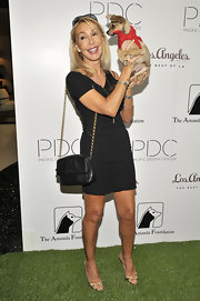 Linda's love for designer bags and designer dogs was evident at 'Patterns for Paws.' Along with her pet, she carried a black chain-strap Chanel bag.