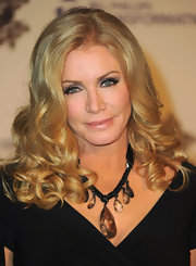 Shannon Tweed wore a statement necklace to accentuate her low neckline.