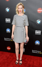 January Jones topped off her ensemble with a metallic silver clutch by Jimmy Choo.