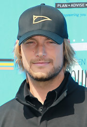 Gabriel Aubry was all geared up for the SAG Foundation Golf Tourney wearing a black baseball cap.