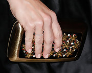 Kristin Davis added some shine to her evening look with a gemstone-inlaid clutch.