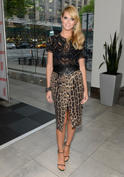 A leopard-print pencil skirt with a front slit added an extra dose of fierceness to Heidi Klum's look.