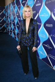 Beth Behrs paired her blazer with classic black slacks, also by Safiyaa.