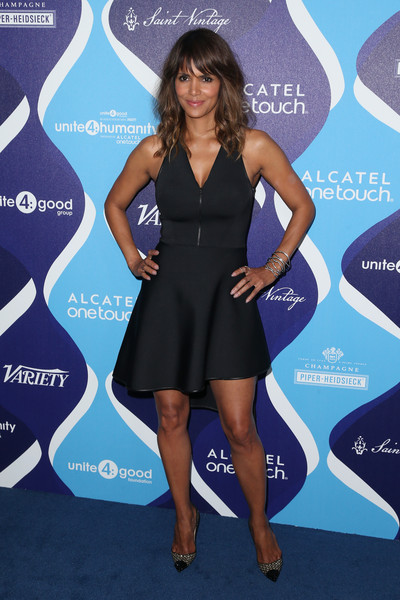 Halle Berry styled her dress with an edgy-glam pair of studded cap-toe pumps.