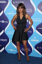 Halle Berry was sporty-sexy in an asymmetrical-hem, zip-front LBD by David Koma at the unite4:humanity event.
