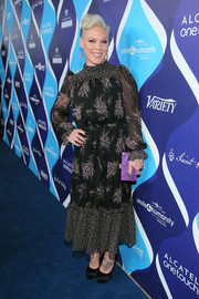 Pink showed her demure side with this long-sleeve, high-neck floral frock by Michael Kors at the unite4:humanity event.