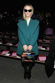 Harley Viera-Newton wore a teal wool coat with a flamboyant fur collar to the 3.1 Phillip Lim fashion show.