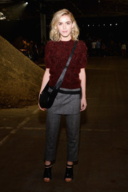 Kiernan Shipka pulled her outfit together with a pair of gray slacks, also by 3.1 Phillip Lim.