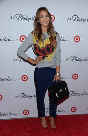 Jessica Alba paired blue slacks with a graphic-print sweater for the 3.1 Phillip Lim for Target launch event.