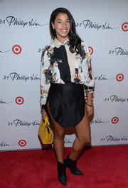 Hannah Bronfman's black ankle boots provided a tough-chic finish to her look.