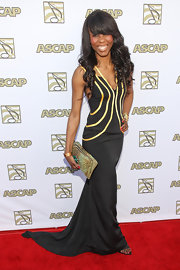 Chanty chose a flowing black gown with yellow stripe detailing for her red carpet look at the ASCAP Pop Music Awards.