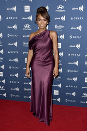 Janet Mock cut a sultry figure in a plum off-one-shoulder gown by Cushnie at the 2019 GLAAD Media Awards.