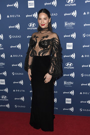 Olivia Munn sizzled in a black Yanina Couture gown with a sheer peacock-embroidered bodice at the 2019 GLAAD Media Awards.
