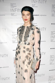 Crystal Renn accessorized with a dazzling crystal-covered clutch at the International Center of Photography Infinity Awards.