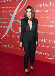Carine Roitfeld teamed her sexy jumpsuit with basic brown platform pumps.