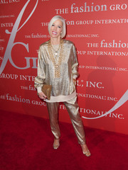 Linda Fargo was sporty-glam at the Annual Night of Stars in a gold sweater and matching pants by Stella McCartney.