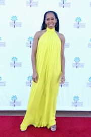 Regina King brightened up the red carpet with her yellow Cushnie halter gown at the Palm Springs International Film Festival screening of 'If Beale Street Could Talk.'