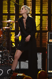 Miley Cyrus was edgy-chic in a black side-mullet tux dress while performing at the Rock and Roll Hall of Fame induction ceremony.