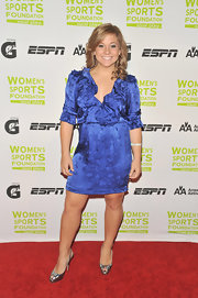 Shawn Johnson donned a blue satin dress with ruffle details on the red carpet. The dress's 3/4 length sleeves and above knee length flattered the petite frame of the former gymnast.