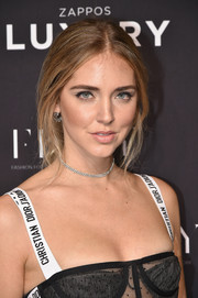 Chiara Ferragni matched her earrings with a silver chain choker.