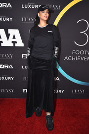 Rihanna went casual in a long-sleeve black tee by Vetements x Juicy Couture at the FN Achievement Awards.