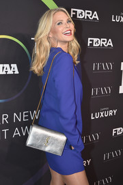 Christie Brinkley showed off a chic silver Saint Laurent shoulder bag at the FN Achievement Awards.
