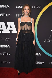 Chiara Ferragni turned heads in a black Dior corset gown with a sheer bodice and a tiered ruffle skirt at the FN Achievement Awards.