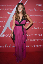 Chrissy Teigen looked like a modern-day goddess in her fuchsia and black DVF wrap gown during the FGI Night of Stars event.