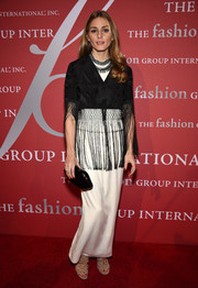 Olivia Palermo layered a fringed, embroidered black wrap over a white gown for the FGI Night of Stars event.
