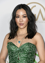 Constance Wu styled her dress with a pair of pendant necklaces.