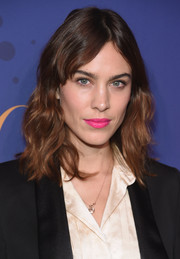 Alexa Chung went for an eye-popping beauty look with a swipe of hot-pink lipstick.