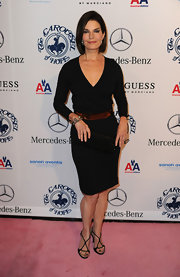 Actress Sela Ward arrived at the 32nd Anniversary Carousel Of Hope Ball at The Beverly Hilton hotel wearing black Swarovski crystal hourglass heels.