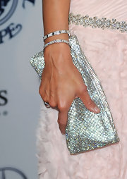 It's no secret that Paris is a fan of all that sparkles. The socialite finished off her baby pink gown with a gleaming silver clutch.