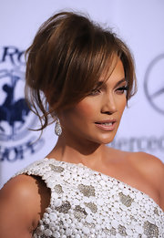Jennifer Lopez never leaves home without her signature bling. The superstar showed off her tear drop diamond earrings.