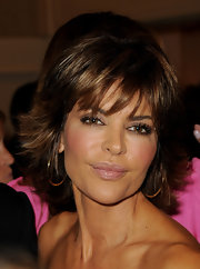 Just a hint of gloss is all Lisa Rinna needed to enhance her lips at the 32nd Carousel of Hope gala. With her bronzed skin and smoky eyes, a little shine was the perfect option.
