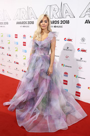 Rita Ora had a princess moment at the 2018 ARIA Awards in a multi-pastel one-shoulder ball gown by Marchesa.