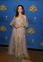 Angelina Jolie took our breath away with this beaded nude gown by Elie Saab Couture at the American Society of Cinematographers Awards.